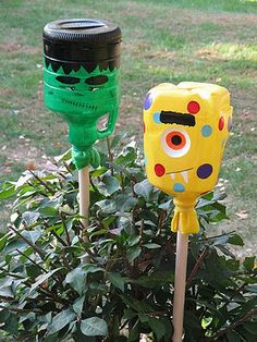 yard lights.. made out of plastic jugs...not a fan of halloween but would be cute as a flag,bunny,or bugs for garden:)
