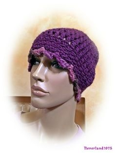 http://www.ravelry.com/projects/neverland1975/93-36-hat-with-pompoms-2