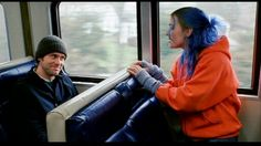 Orange zip up with fingerless gloves and blue hair for Clementine. Hat for Joel.