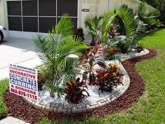 Putting in an edge around the curbing may be the perfect way to keep the grass out of the flower beds!