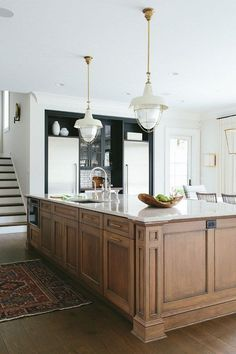 Many are dreaming of freshly painted cabinets but here's some stunning stained ones!