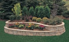 I like this idea for a flower bed retaining wall in front of the house.