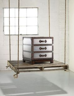 Country meets city in the Bondurant Accent Chest with its faux zinc finish and leather and nail head trim.    Three drawers with leather strap pulls.    Hardwood Solids, Leather, Silver Leaf.