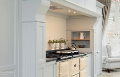 gorgeous stove inset via South Shore Decorating Blog: The Kitchen That Has Me Speechless