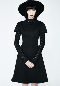 Disturbia Covenant Dress got ya feelin' extra witchy tonight. This black dress has a pointy collar with a safety pin detail and black lace sleeves.