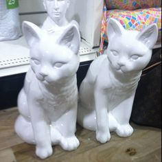 I really want these porcelain cat figurines for my apartment but my mom said no....tacky or chic????