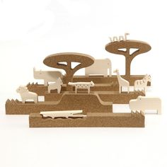 Set of 10 wooden animals and 5 cork profiles that represent different landscape environments.