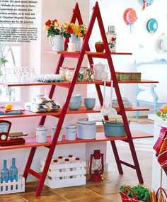 use of an old ladder to display items-love the red