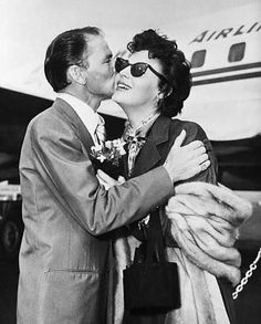 Frank Sinatra kissing the face of his wife, Ava Gardner.