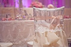 Wedding Chair Swag Decorations -  This adorable lace and ruffle chair cover with bow is pretty and feminine!
