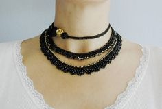 Crocheted necklace in black with Japanese seed beads. The beads are Miyuki Black Amber and Black Preciosa Ornela. I made this three-pieces necklace with a microfiber thread. The first part decorated with crocheted roses. The other two parts are decorated with different beaded