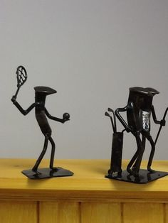 golfers and tennis player scupltures made from railroad pins by Roland Metal Art  #tennis #golf #golfers #player #metal #sculpture #twohens