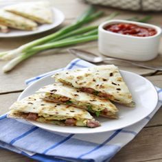 Breakfast Burrito Quesadilla - add scrambled eggs, diced, ham, cheese & green onions. :)