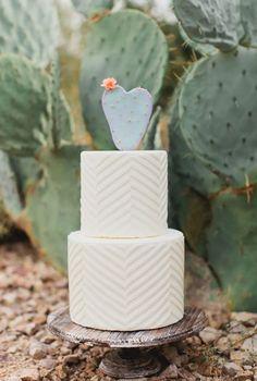 Chevron buttercream + a heart cactus cake topper = a winning desert-inspired dessert combo.