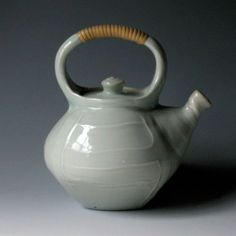 celadon teapot with wrapped cane handle