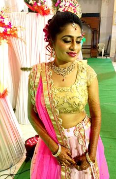 Indian bride wearing bridal hair, lehenga and jewellery. Reception look. Makeup by Swank Studio. Find us at https://www.facebook.com/SwankStudioBangalore
