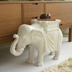 NEED FOR DORNA-white ceramic elephant stool - just got a great deal on one at my local coffeeshop, and I can't wait to put it in my yoga/meditation space at the new house!