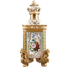 Perfume Bottle by Jacob Petit  France  Circa 1835  This charming and rare porcelain perfume bottle by Jacob Petit is a work of delicate beauty. Crafted in a rare square form, this intricate bottle is decorated with four panels of hand-painted flowers, each completely different, and sits upon four swan-form feet.