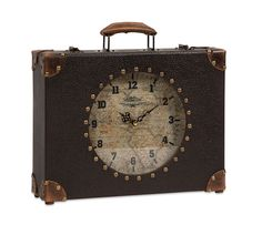 Old world charm and a traveler's mystique are packed in this World Map Suitcase Clock. The perfect size for a desktop, mantle or shelf, this clock will tell you when it's time to travel.