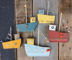 Fishing Fleet' Pale blue and yellow original handmade colourful fishing boat wall hanging. Made from driftwood, reclaimed materials and wood from old beach huts. Beach Crafts, Summer Crafts, Diy And Crafts, Arts And Crafts, Driftwood Fish, Driftwood Crafts, Wood Block Crafts, Fish Art, Beach Art