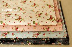 Floral cotton fabric with red roses