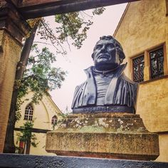 A bust of Martin Luther sits outside the house where he was born Eisleben Germany