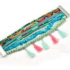 Colorful multi strand bracelet I love this, girly, cute, fresh, cool, fashionable! Perfect for summer, the beach, music festivals. comes in a super cute pouch to store it. It has a super strong magnetic clasp. You will love it! The picture is of the actual bracelet. Price is firm. Jewelry Bracelets