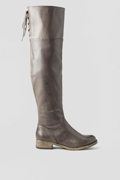 Bring out your cool girl style with the Minute Over the Knee Boot by MIA.A sleek faux leather shaft scales the height of the knee and is adorned withlaces at the back of the topline.With a printed dress and crossbody, theMinuteOver the KneeBoot will add a little bit of edge to
