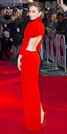 LILY COLLINS It's not every day that you can own ultra-glam celeb red carpet looks, but the scarlet Solace London turtleneck gown Lily wore to the Love, Rosie in London is available in black for $425. Tragically, the abs required to pull it off aren't included.