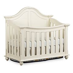 The stunning Benbrooke 4-in-1 Convertible Crib by Bassettbaby PREMIER will be the centerpiece of your relaxed traditional nursery. Its beautifully arched headboard boasts intricate curves, and the bun feet offer heirloom charm that grows with your baby.