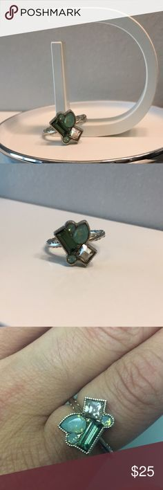 Swarovski Rock Candy ring Stunning Swarovski Rock Candy ring from Jessica Elliot. Rhodium plated brass with a gorgeous cluster of Swarovski crystals in beautiful shades of green. Comes with white gift box. Pacific Opal size 7 ⭐️MADE IN USA⭐️ Jessica Elliot Jewelry Rings