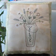 This decorative hand embroidered accent pillow is approximately 9X 11. The simple bucket of blossoms floral design with the welcome on the bucket is hand embroidered on tea-dyed muslin. The design is bordered in vintage fabric and backed with complimentary fabric. The design is compliments of Rita of Cedarberry Stitches. This is a decorative pillow and is NOT WASHABLE.  I will combine shipping for multiple items. Please refer to my shipping policies for additional information. This item will…