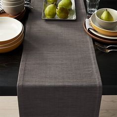 Rich hand-dyed colors in subtle tone-on-tone hues are handwoven into a grasscloth-textured table runner. Old-world, handcrafted techniques used by skilled weavers in the remote villages of Kerala, India, are the secret to the exceptional beauty of these exclusive runners.