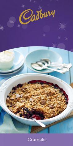 Combining berries with chocolate chunk crunch: genius. This Berry Choc Crumble is a delicious, easy family dessert for any night of the week. #bakeitdelicious #baking #chocolate #dessert #crumble