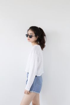 casual laidback ❌school❌ [white longsleeves with thin cloth + acid-washed, high-waisted denim shorts without frays on bottom + black sunglasses + ponytail/messy hair] Korean Street Fashion, Korea Fashion, Asian Fashion, Look Fashion, Girl Fashion, Fashion Outfits, Womens Fashion, Fashion Trends, Vintage Hipster