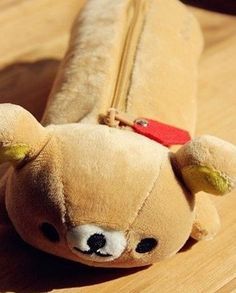 Rilakkuma comes to you as a soft, cuddly light brown pencil pouch and loves your company! Rilakkuma has a soft white underbelly with yellow paws and yellow ears, and a zip closure to securely hold all