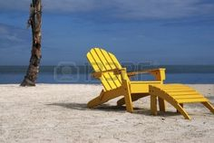 A Inviting Scene Of A Comfortable Yellow Beach Chair On A Tropical ...