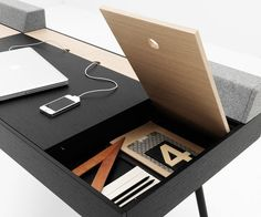 Cupertino | BoConcept. Love the felt blocks behind the desktop compartments—think they're there so if you've got stuff sitting on the panel, it won't fall off when you open it