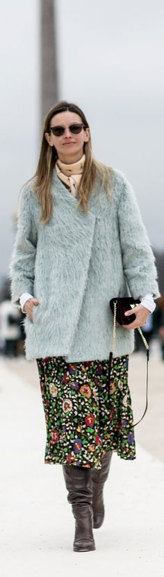 Paris Fashion Week street style: boots and a floral skirt topped with a furry coat