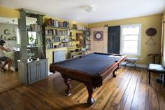 """The game room is full of DIY projects; the dart and chalk board was built to house a ping pong tabletop."" Liz & Adam's Eclectic Home With a Modern Sensibility (and a Treehouse! Modern Pools, Industrial House, Furniture Making, Game Room, House Tours, Interior Inspiration, Treehouse, Chalk Board, Tabletop"