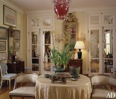 Room of the Day: Mirrored interior french doors extend the space in late designer Anthony Hail's luxurious San Francisco home. Art, lamps, skirted table, soft tones. 1.27.2014