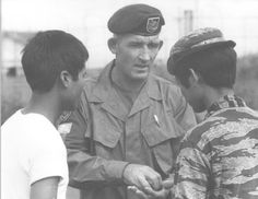 Warrant Officer Second Class Alex McCloskey of Newcastle, NSW explaining something to a Montagnard soldier.