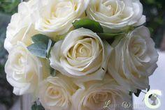 Bridesmaid bouquet of ivory roses with eucalyptus foliage