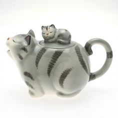 big grey tabby (striped) cat teapot, yawning mouth as spout, kitten on back as knob, curled tail as lid, ceramic