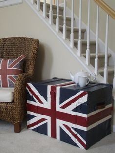 Union Jack tea-chest in front of staircase.