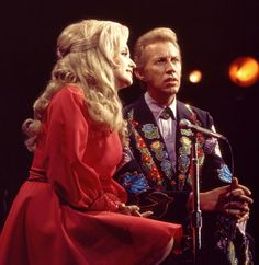 Porter Wagoner and Dolly Parton in concert.