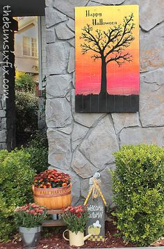 Large sheet of beadboard painted to create a bright holiday sign for the front walk