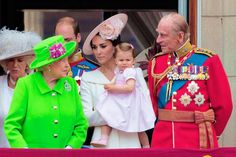 Catherine, Duchess of Cambridge holding her daughter Princess Charlotte, and Prince William, Duke of Cambridge watching his son Prince George stand on the balcony of Buckingham Palace to watch a fly-past of aircrafts by the Royal Air Force, in London on June 11, 2016.