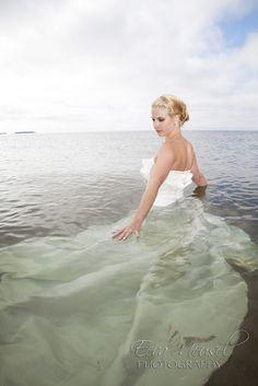 destroying the dress ....? I love this idea!  After all the pretty pictures, have the while wedding party jump into the ocean / pool/ throw cake @ each other ..... Or just the bride & groom :-)