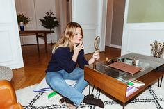 On everything she packs for a night out—a mini camera, YSL lipstick, cell phone, et al, plus more tips from the L'Officiel editor.